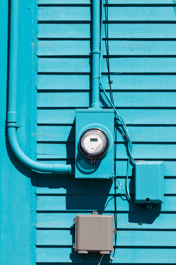 Smart grid electric meter connection on blue wall - Stock Photo - Images