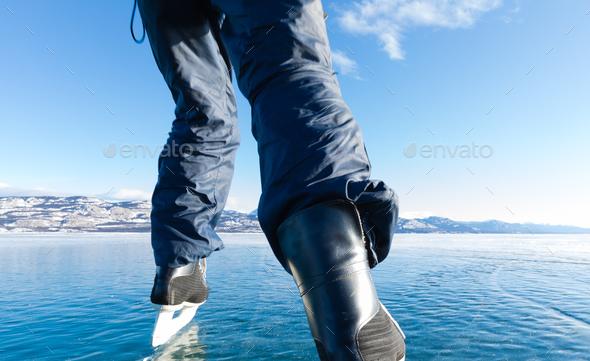 Skating frozen Lake Laberge Yukon Canada - Stock Photo - Images