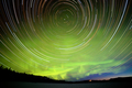 Star trails and Northern lights in night sky - PhotoDune Item for Sale