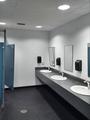 Clean simple public washroom sinks toilet stalls - PhotoDune Item for Sale