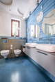 Bathroom with blue tiles and mirrors