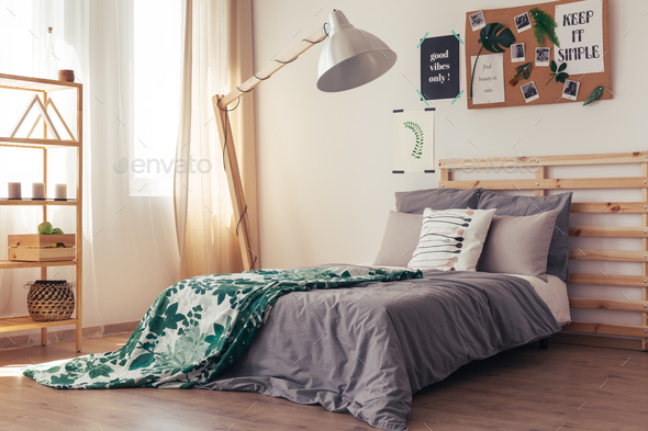 Contemporary bedroom with botanic duvet - Stock Photo - Images