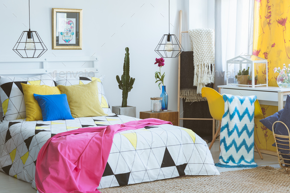 Colorful bedroom with glass terrarium - Stock Photo - Images