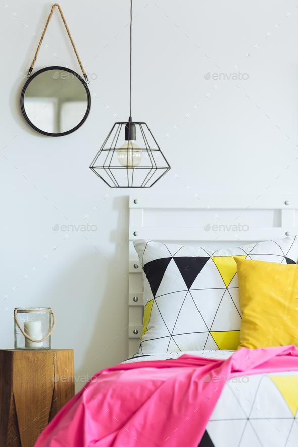 Geometric bedroom with round mirror - Stock Photo - Images