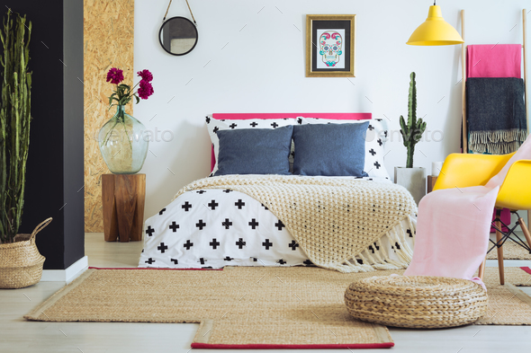 Vividly multicolored folk bedroom - Stock Photo - Images