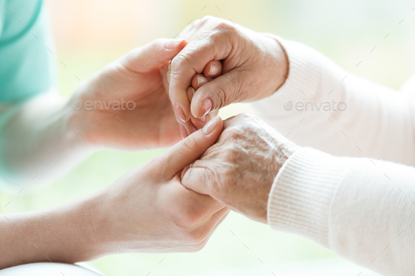 Close-up of holding hands - Stock Photo - Images
