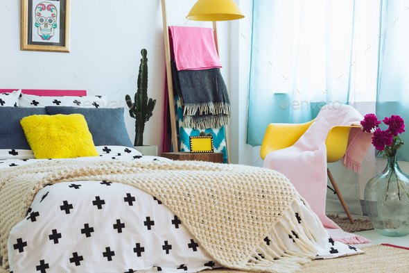 Trendy bedroom with colorful bedding - Stock Photo - Images