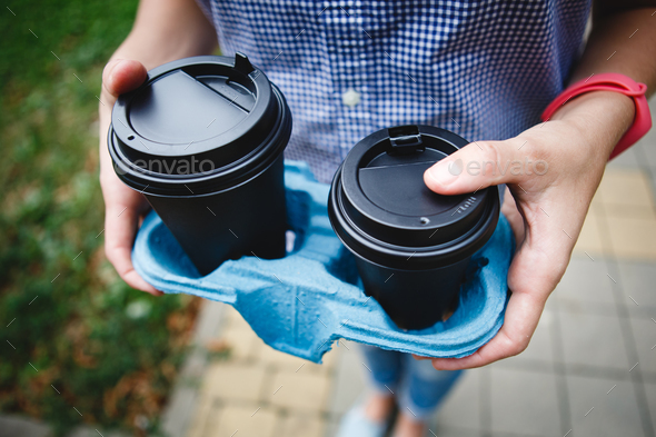 Crop person holding coffee cups - Stock Photo - Images