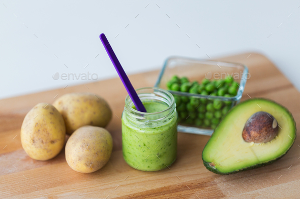 jar with puree or baby food on wooden board - Stock Photo - Images
