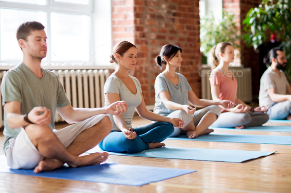 group of people making yoga exercises at studio - Stock Photo - Images