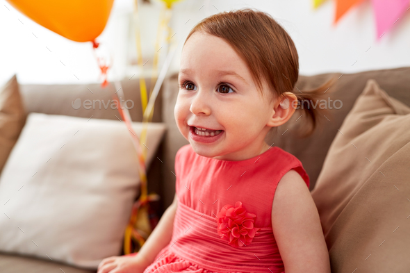 happy baby girl on birthday party at home - Stock Photo - Images