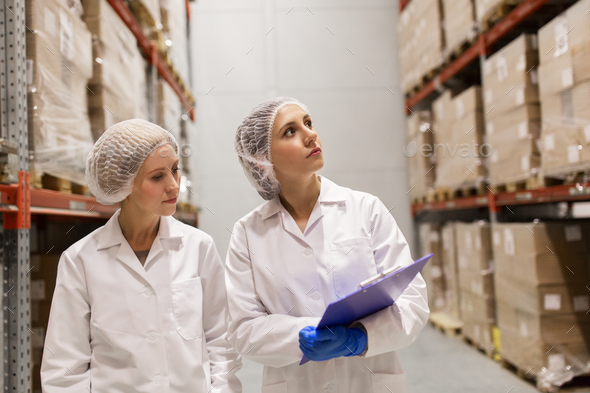 women technologists at ice cream factory warehouse - Stock Photo - Images