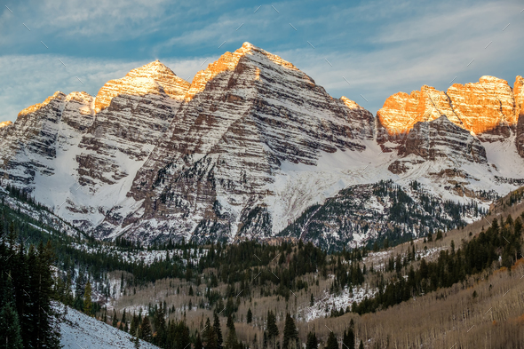 Maroon Bells mountains in snow at sunrise - Stock Photo - Images