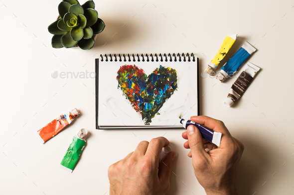 Acrylic hearts on notebook - Stock Photo - Images