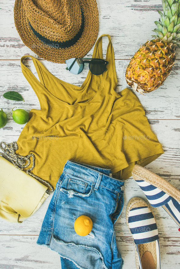 Colorful summer fashion outfit flat-lay over pastel parquet background - Stock Photo - Images
