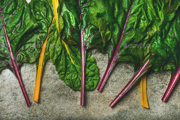 Flat-lay of fresh green leaves of swiss chard, top view - Stock Photo - Images