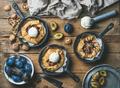 Plum and walnut crostata pie with ice-cream scoops