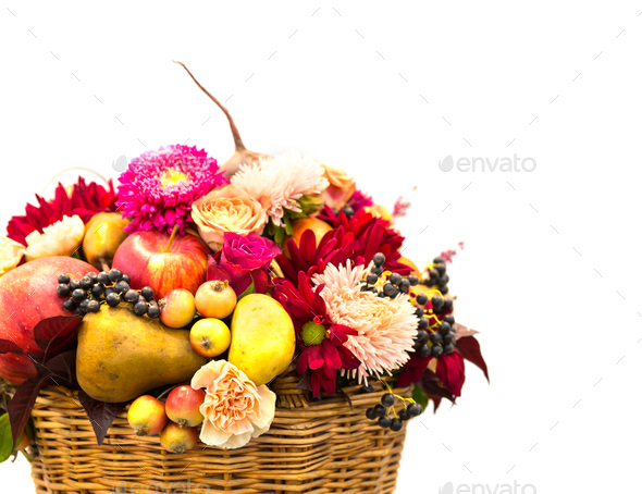 Ripe fruits and flowers composition in a basket - Stock Photo - Images