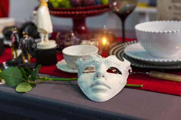 Christmas table decorated with mask and flower - Stock Photo - Images