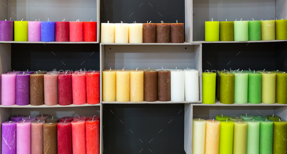 Colorful candles on shelf in decoration shop - Stock Photo - Images
