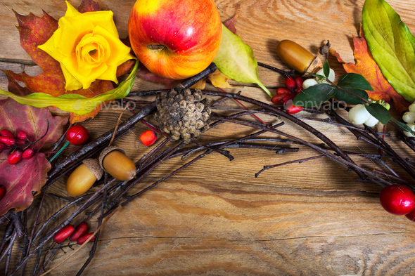 Thanksgiving wreath with apple, cones, berries, acorns - Stock Photo - Images