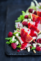 Delicious salad with fresh figs, duck meat and raspberry sauce