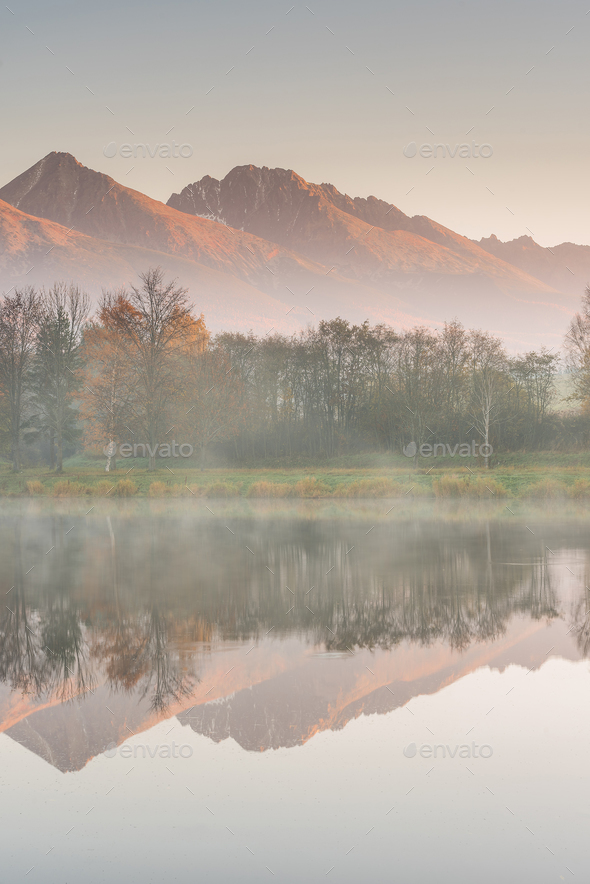 Stunning high peak reflection in lake and autumn foliage - Stock Photo - Images