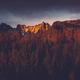 Last sun light hits high mountains peak at sunset - PhotoDune Item for Sale