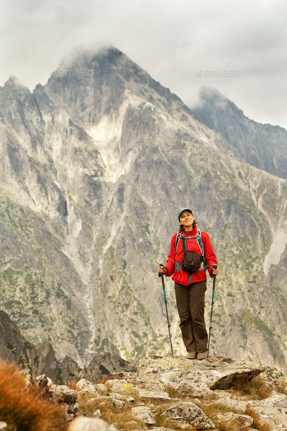 Hiking woman happy to be in the mountains - Stock Photo - Images