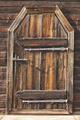 Antique rusted locked wooden door. Finland background heritage. Vertical