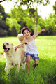Young girl with golden retriever running - PhotoDune Item for Sale