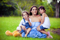 Mother and two daughters playing in grass - PhotoDune Item for Sale