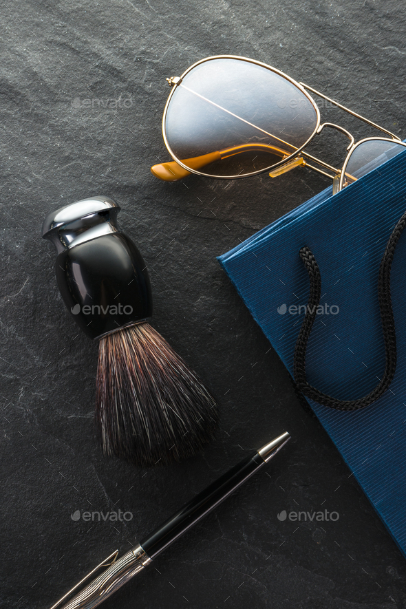 Black Friday, sale, gifts glasses, shaving brush and pen close-up - Stock Photo - Images