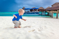Cute little boy looking for treasure on the tropical beach - PhotoDune Item for Sale