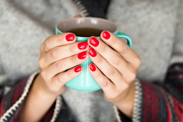 Hands holding a mug - Stock Photo - Images