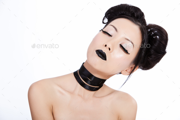Young asian female with black makeup - Stock Photo - Images