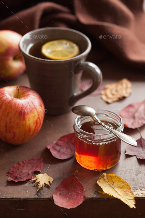 hot lemon honey tea warming drink scarf cozy autumn leaves - Stock Photo - Images