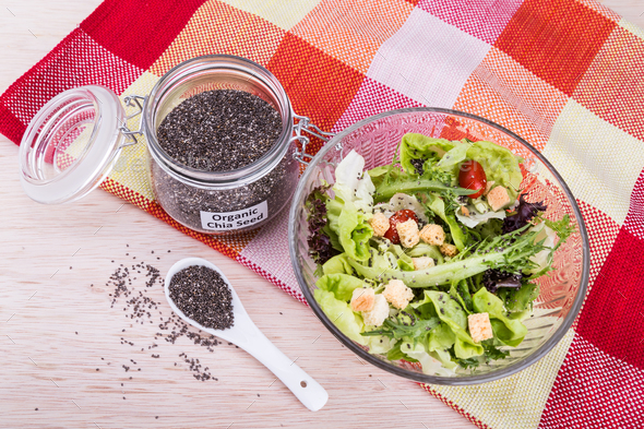 Organic chia seeds with salad healthy meal loaded with antioxida - Stock Photo - Images