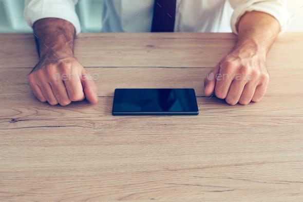 Businessman fighting mobile phone addiction crisis - Stock Photo - Images