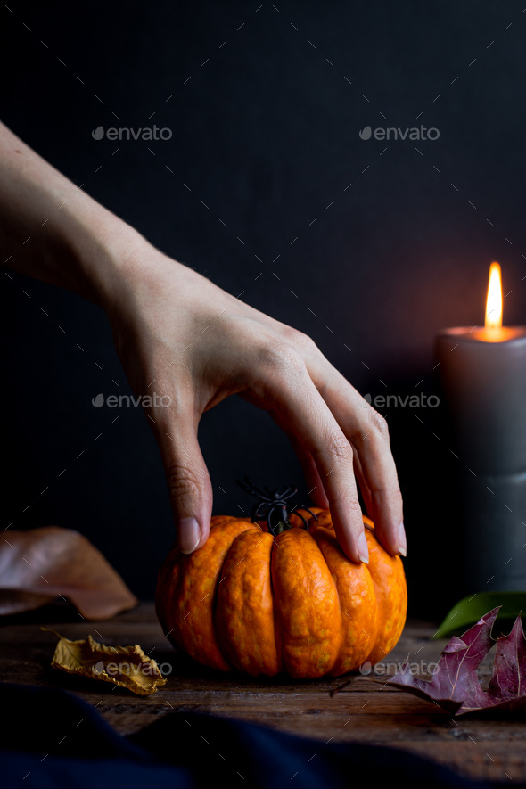 Spooky Hand and Halloween Pumpkin - Stock Photo - Images