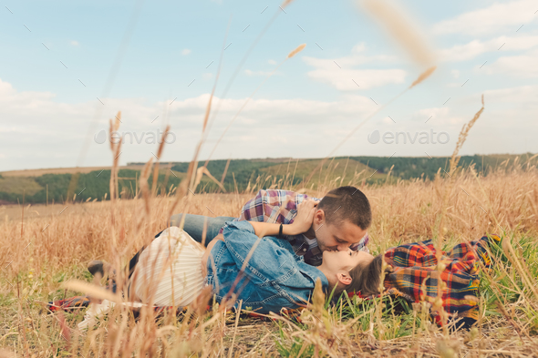 Young modern stylish couple outdoors - Stock Photo - Images