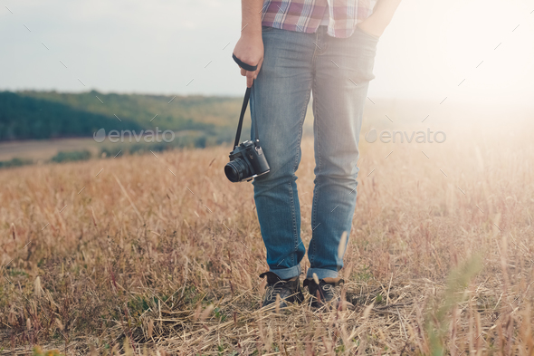 Attractive male photographer outdoors at sunset - Stock Photo - Images