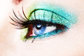 Detail of a blue eye with green eyeshade - PhotoDune Item for Sale