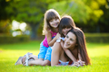 Young mother and two daughters playing outdoors - PhotoDune Item for Sale