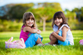Two young smiling girls sitting in the grass - PhotoDune Item for Sale