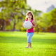 Young girl in the park holding white ball - PhotoDune Item for Sale
