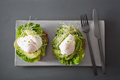 breakfast toast with avocado, poached egg and alfalfa sprouts - PhotoDune Item for Sale