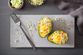 egg baked in avocado with spring onion and alfalfa sprouts - PhotoDune Item for Sale