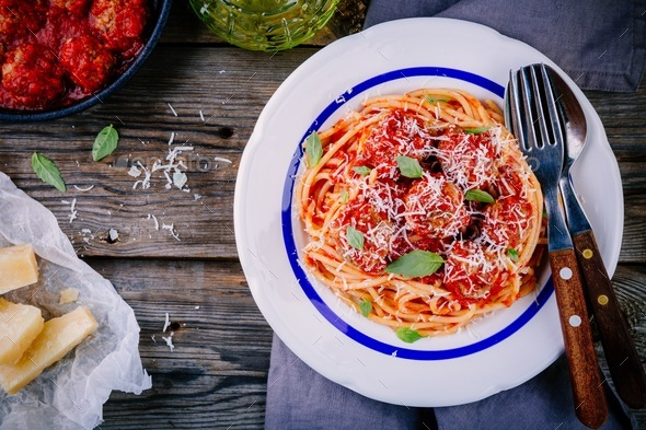 Spaghetti pasta with meatballs, tomato sauce and parmesan cheese - Stock Photo - Images