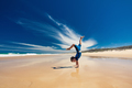 Acrobatic young boy performing hand stand on the beach - PhotoDune Item for Sale